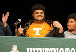 Darnell Wright reveals he plans to sign a letter of intent to attend and play football at Tennessee, Wednesday, Feb. 6, 2019, at Huntington (W.Va.) High School. (Sholten Singer/The Herald-Dispatch via AP)