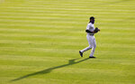 Colorado Rockies right fielder Charlie Blackmon casts a shadow as he takes his position in the third inning of a baseball game against the San Diego Padres, Saturday, Aug. 1, 2020, in Denver. (AP Photo/David Zalubowski)