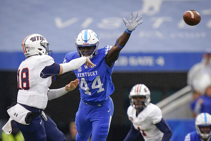Kentucky linebacker Jamin Davis (44) rushes UT Martin quarterback John Bachus III (18) during the first half of an NCAA college football game, Saturday, Nov. 23, 2019, in Lexington, Ky. (AP Photo/Bryan Woolston)
