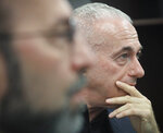 Barry Singer, right, and Jay Goldberg, left, who say they were sexually abused while they were students at Marsha Stern Talmudical Academy (MTA)—also known as Yeshiva University High School for Boys in Manhattan, listen during a press conference, Thursday Aug. 22, 2019, in New York. They are among 38 former students in a lawsuit alleging sexual abuse by two rabbis: George Finkelstein, a long-time MTA principal, and Macy Gordon, a long-time MTA Judaic Studies teacher. (AP Photo/Bebeto Matthews)