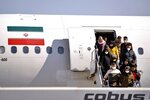 Passengers disembarking from an Iranian plane in the airport in Najaf, Iraq, Friday, Feb. 21, 2020. Iraqi authorities are taking precautions at Najaf and other Iraqi airports, as well as at the border gates with Iran, after the discovery of the new virus that emerged in China in Iran. (AP Photo/Anmar Khalil)