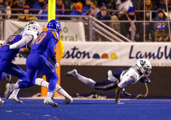 Utah State wide receiver Savon Scarver (81) dives for extra yards on a kick return against Boise State in the second of an NCAA college football game, Saturday, Nov. 24, 2018, in Boise, Idaho. Boise State won 33-24. (AP Photo/Steve Conner)