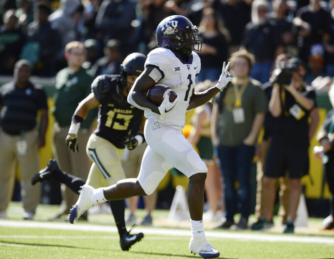 TCU wide receiver Jalen Reagor scores past Baylor cornerback Raleigh Texada in the second half of an NCAA college football game, Saturday, Nov. 17, 2018, in Waco, Texas. (Ernesto Garcia/Waco Tribune-Herald via AP)