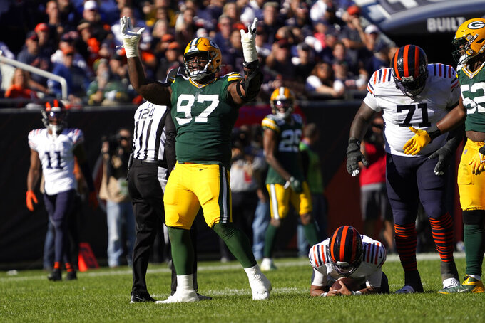 Green Bay Packers nose tackle Kenny Clark (97) celebrates his sack of Chicago Bears quarterback Justin Fields during the second half of an NFL football game Sunday, Oct. 17, 2021, in Chicago. The Packers won 24-14. (AP Photo/David Banks)