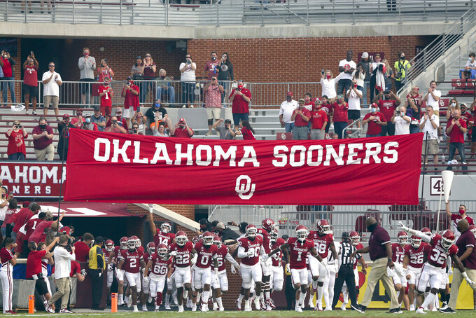 Fans cheer as Oklahoma players run onto the field for the team's NCAA college football game against Missouri State in Norman, Okla., Saturday, Sept. 12, 2020. (Ian Maule/Tulsa World via AP)