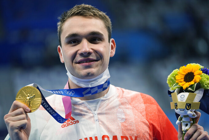 Kristof Milak of Hungary poses with his gold medal after winning the men's 200-meter butterfly final at the 2020 Summer Olympics, Wednesday, July 28, 2021, in Tokyo, Japan. (AP Photo/Martin Meissner)