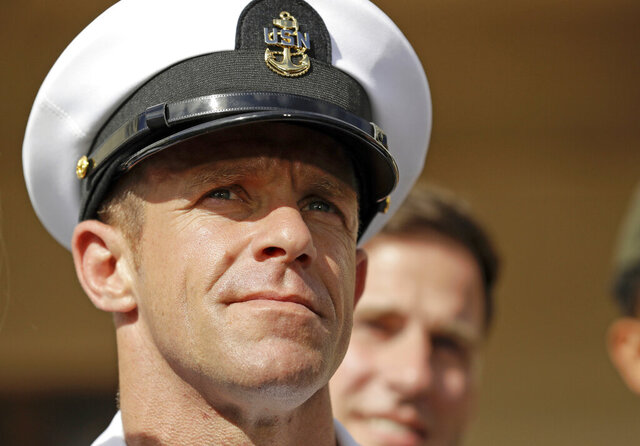FILE - In this July 2, 2019, file photo, Navy Special Operations Chief Edward Gallagher leaves a military court on Naval Base San Diego. Navy SEALs described their platoon leader, retired Special Operations Chief Gallagher, as