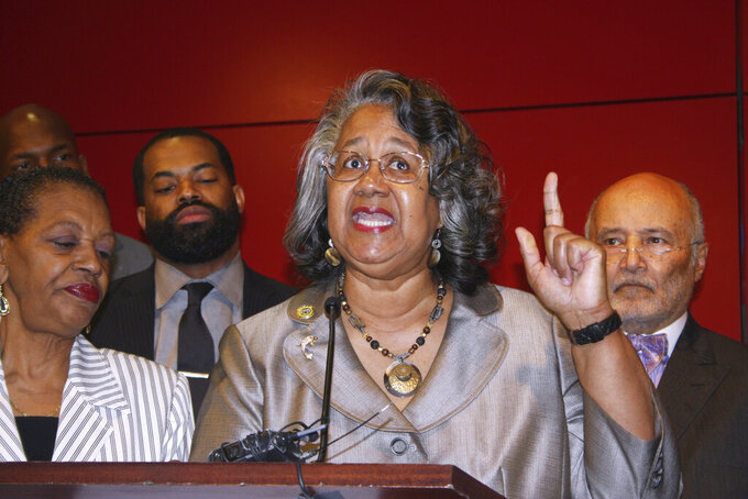 FILE - Delegate Cheryl Glenn, a Baltimore Democrat, calls for a special session to approve additional licenses to grow medical marijuana during a news conference April 12, 2017, in Baltimore. The former Maryland state lawmaker has been sentenced to two years in prison for taking bribes for legislative favors. U.S. District Judge Catherine Blake on Wednesday, July29, 2020, ordered former Del. Glenn to pay $18,750 in restitution. Glenn represented parts of Baltimore as a state delegate. The 69-year-old Democrat resigned in December and pleaded guilty in January to a bribery-related charge and honest services wire fraud. Glenn admitted that she accepted five bribe payments totaling $33,750 over an 11-month period in 2018 and 2019. Glenn told Judge Blake that she hopes other public officials can learn from her mistakes. (AP Photo/Brian Witte, File)
