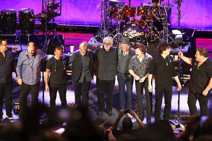 The Doobie Brothers stand on the stage at The Doobie Brothers at Ryman Auditorium, Monday, Nov. 18, 2019, in Nashville, Tenn. (Photo by Al Wagner/Invision/AP)