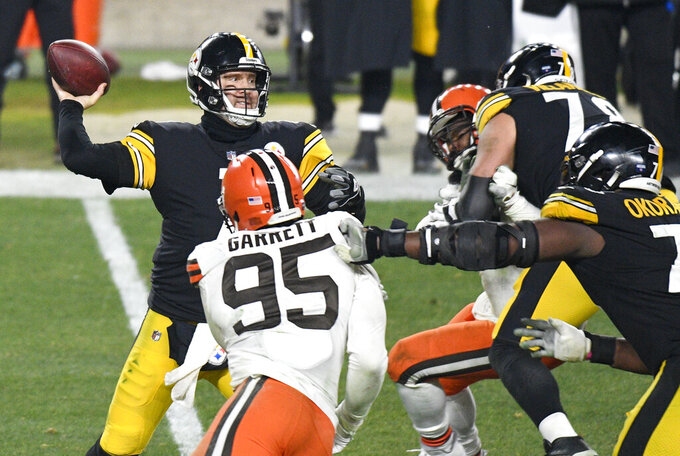 Pittsburgh Steelers quarterback Ben Roethlisberger (7) throws a pass during the second half of an NFL wild-card playoff football game against the Cleveland Brownsin Pittsburgh, Sunday, Jan. 10, 2021. (AP Photo/Don Wright)