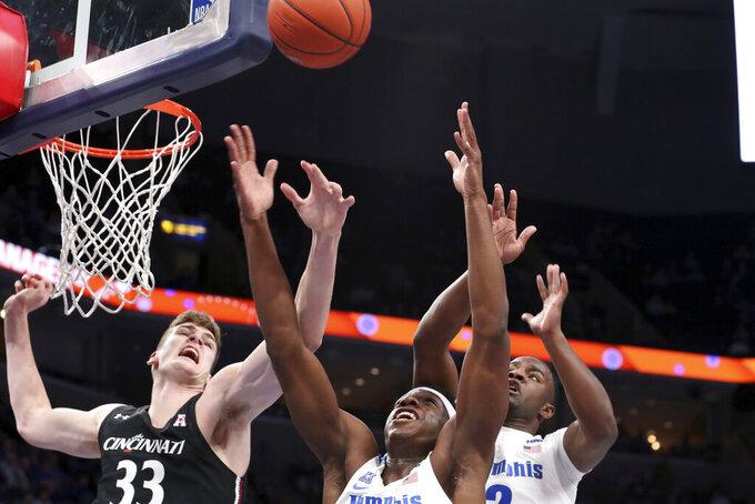 Memphis' forward Malcomb Dandridge ( 23) and Cincinnati's center Chris Vogt (33) go up for a rebound in the first half of an NCAA college basketball game Thursday, Jan. 16, 2020, in Memphis, Tenn. (AP Photo/Karen Pulfer Focht)