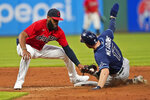 Cleveland Indians' Amed Rosario, left, tags out Tampa Bay Rays' Austin Meadows at second base on a steal attempt during the sixth inning of a baseball game Thursday, July 22, 2021, in Cleveland. (AP Photo/Tony Dejak)
