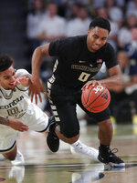 Wake Forest guard Brandon Childress (0) gets past Georgia Tech guard Michael Devoe (0) during the first half of an NCAA college basketball game, Saturday, Jan. 5, 2019, in Atlanta. (AP Photo/John Bazemore)