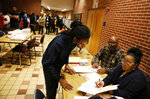 Sebastian Snelling, left, is given instructions on using a paper ballot as the precinct switched over from electronic voting machines after a judge ordered the location to remain open until 10 p.m., a full three hours after polls closed statewide, in Atlanta, Tuesday, Nov. 6, 2018. (AP Photo/David Goldman)
