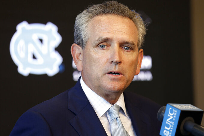 "FILE - In this Aug. 6, 2018, file photo, University of North Carolina athletic director Bubba Cunningham makes comments during the NCAA college football team's media day in Chapel Hill, N.C.  North Carolina had enough coaching changes last season to surprise even athletics director Bubba Cunningham. Cunningham hired five new head coaches for next season, telling The Associated Press that hopes the changes create ""an enthusiasm, a vibrancy … and an excitement about the future.""  (AP Photo/Gerry Broome, File)"