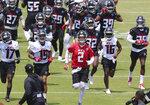 Atlanta Falcons quarterback Matt Ryan (2) leads the team across the field to begin an NFL football organized team activity in Flowery Branch, Ga,., Tuesday, May 25, 2021. (Curtis Compton/Atlanta Journal-Constitution via AP)