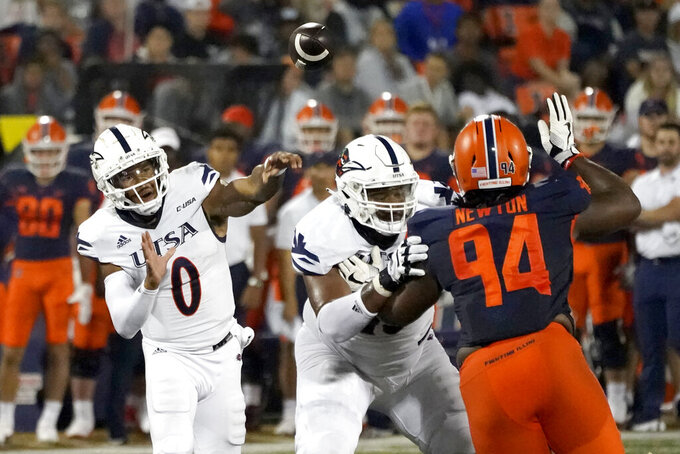 UTSA quarterback Frank Harris (0) passes during the first half of an NCAA college football game against Illinois, Saturday, Sept. 4, 2021, in Champaign, Ill. (AP Photo/Charles Rex Arbogast)