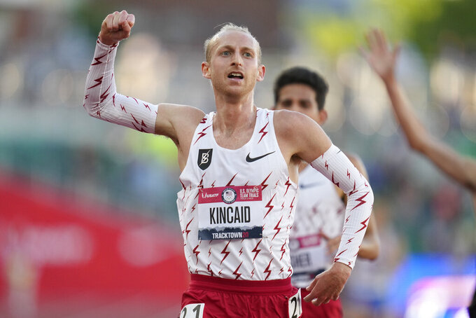 Woody Kincaid celebrates after winning the men's 10000-meter run at the U.S. Olympic Track and Field Trials Friday, June 18, 2021, in Eugene, Ore. (AP Photo/Ashley Landis)