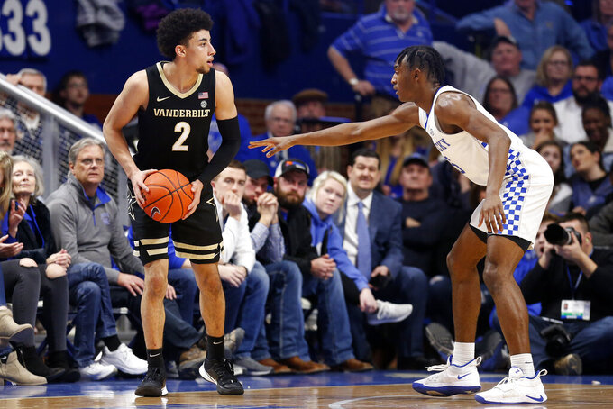 Vanderbilt's Scotty Pippen Jr. (2) looks for an opening as Kentucky's Immanuel Quickley defends during the second half of an NCAA college basketball game in Lexington, Ky., Wednesday, Jan 29, 2020. (AP Photo/James Crisp)