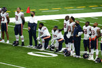 Chicago Bears' Bobby Massie (70) and Charles Leno Jr. (72) kneel during social justice video before an NFL football game against the Detroit Lions in Detroit, Sunday, Sept. 13, 2020. (AP Photo/Paul Sancya)