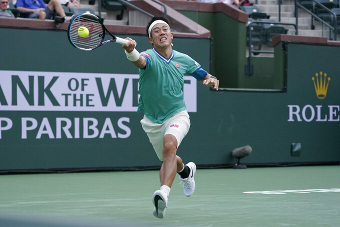 Kei Nishikori, of Japan, returns a shot to Joao Sousa, of Portugal, at the BNP Paribas Open tennis tournament Thursday, Oct. 7, 2021, in Indian Wells, Calif. (AP Photo/Mark J. Terrill)