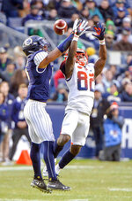 Syracuse wide receiver Nykeim Johnson (82) misses pass during the first half of an NCAA college football game against Notre Dame, Saturday, Nov. 17, 2018, at Yankee Stadium in New York. (AP Photo/Howard Simmons)