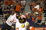 Illinois tight end Daniel Barker, right, is unable to catch a pass in the end zone from quarterback Brandon Peters as Maryland defensive back Nick Cross defends during the first half of an NCAA college football game Friday, Sept. 17, 2021, in Champaign, Ill. (AP Photo/Charles Rex Arbogast)
