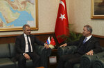 Turkish Defence Minister Hulusi Akar, right, and Russia's Defence Minister Sergei Shoigu speak in Ankara, Turkey, Monday, Feb. 11, 2019. Shoigu said at the start of Monday's meeting with his Turkish counterpart Akar that the two countries' experts have done