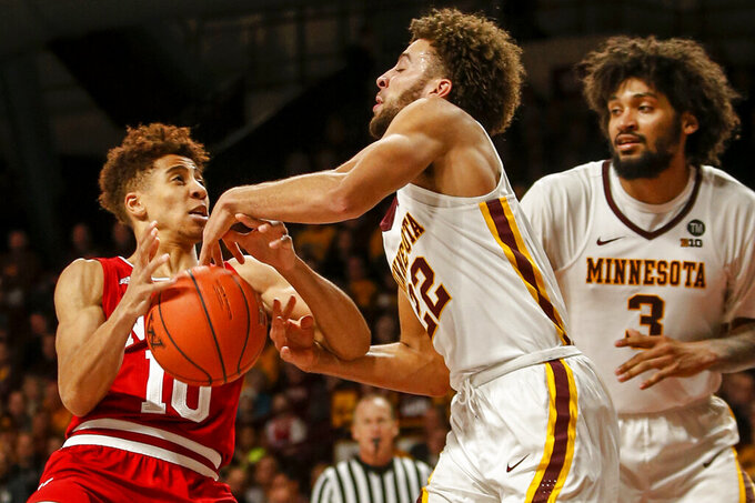 Minnesota's Gabe Kalscheur (22) strips the ball away from Indiana's Rob Phinisee (10) as Jordan Murphy (3) watches in the second half of an NCAA college basketball game Saturday, Feb. 16, 2019, in Minneapolis. Minnesota won 84-63. (AP Photo/Bruce Kluckhohn)