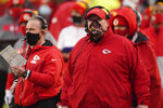 Kansas City Chiefs head coach Andy Reid, right, watches from the sideline during the first half of an NFL football game against the Los Angeles Chargers, Sunday, Jan. 3, 2021, in Kansas City. (AP Photo/Charlie Riedel)