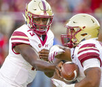 Boston College quarterback Anthony Brown hands off to running back AJ Dillon in the second quarter of an NCAA college football game in Tallahassee, Fla., Saturday, Nov. 17, 2018. (AP Photo/Mark Wallheiser)