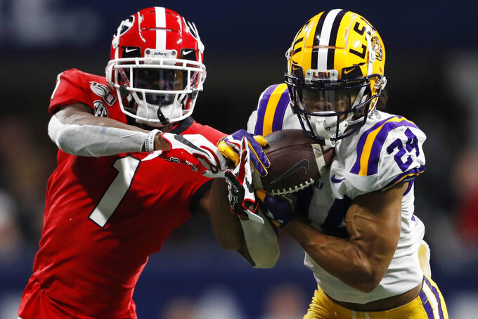 FILE - In this Dec. 7, 2019, file photo, LSU cornerback Derek Stingley Jr. (24) intercepts the ball from Georgia wide receiver George Pickens (1) during the second half of the Southeastern Conference championship NCAA college football game, in Atlanta. Stingley was selected to The Associated Press All-America team, Monday, Dec. 16, 2019. (AP Photo/John Bazemore, File)