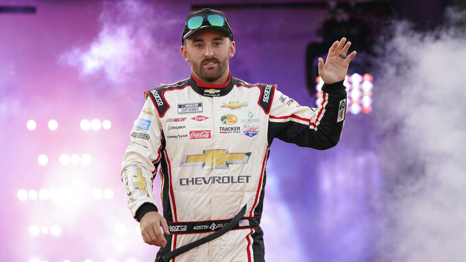 Austin Dillon waves to the crowd during driver introductions prior to the start of the NASCAR Cup series auto race in Richmond, Va., Saturday, Sept. 11, 2021. (AP Photo/Steve Helber)