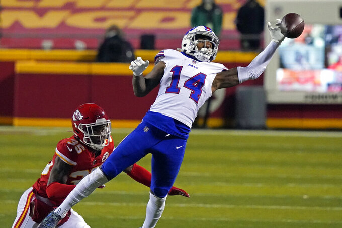 Buffalo Bills wide receiver Stefon Diggs (14) looks to catch a pass over Kansas City Chiefs cornerback Charvarius Ward, left, during the first half of the AFC championship NFL football game, Sunday, Jan. 24, 2021, in Kansas City, Mo. The pass was incomplete. (AP Photo/Jeff Roberson)