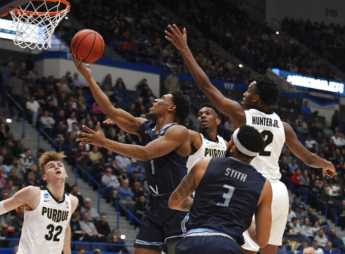 Old Dominion's Jason Wade goes up for a basket between the defense of Purdue's Aaron Wheeler and Eric Hunter Jr., right, during the first half of a first round men's college basketball game in the NCAA tournament, Thursday, March 21, 2019, in Hartford, Conn. (AP Photo/Jessica Hill)