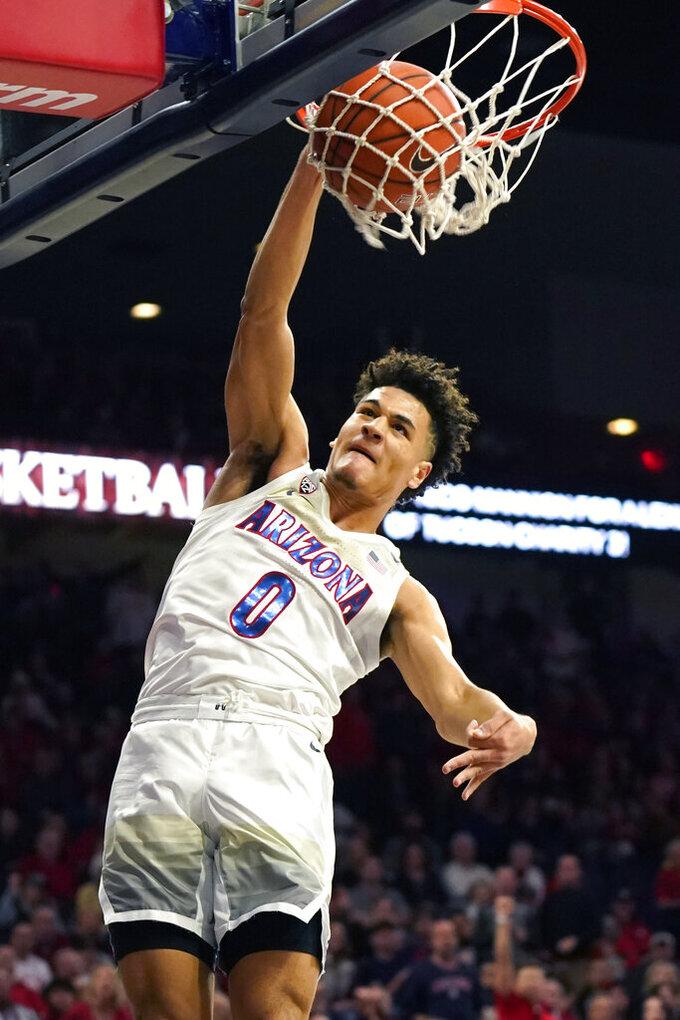 Arizona guard Josh Green dunks against Southern California during the second half of an NCAA college basketball game Thursday, Feb. 6, 2020, in Tucson, Ariz. Arizona won 85-80 (AP Photo/Rick Scuteri)
