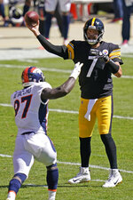 Pittsburgh Steelers quarterback Ben Roethlisberger (7) passes under pressure by Denver Broncos linebacker Jeremiah Attaochu (97) during the first half of an NFL football game, Sunday, Sept. 20, 2020, in Pittsburgh. (AP Photo/Keith Srakocic)