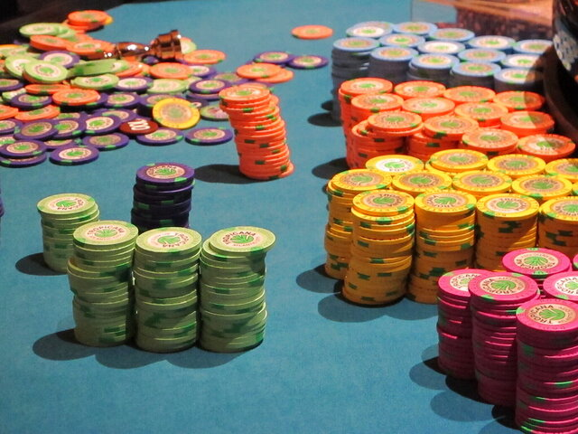 This April 17, 2015 photo shows stacks of gambling chips on a roulette table at the Tropicana Casino and Resort in Atlantic City, N.J. On June 16, 2020, the American Gaming Association, the casino industry's national trade group, called on state gambling regulators to make it easier for gamblers to use cashless betting options during the coronavirus outbreak. (AP Photo/Wayne Parry)