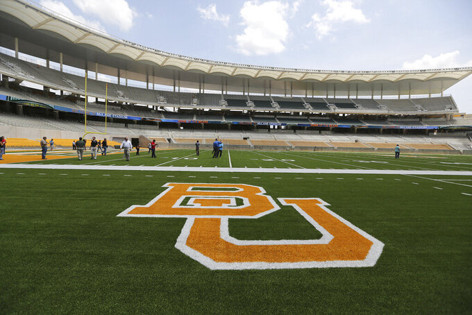 FILE - This Aug. 18, 2014 file photo shows the Baylor University logo on the football field at McLane Stadium in Waco, Texas. BYU coach Kalani Sitake knows his players are looking forward to the change of scenery, the chance to try some different foods and a game in a different region of the country. What nobody knew when this trip was scheduled more than five years ago, or even before this season started, was that Saturday's game at Baylor would provide the 19th-ranked Cougars a sneak peek of their new conference home.  (Rod Aydelotte/Waco Tribune-Herald via AP, File)