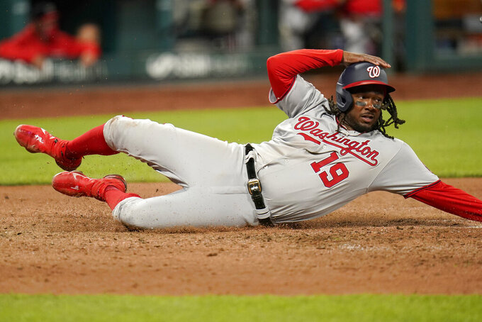 Washington Nationals' Josh Bell scores during the sixth inning of a baseball game against the St. Louis Cardinals Monday, April 12, 2021, in St. Louis. (AP Photo/Jeff Roberson)