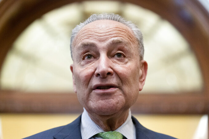 Senate Majority Leader Chuck Schumer of N.Y., speaks with reporters at the Capitol in Washington, Thursday, June 24, 2021. A bipartisan group of lawmakers have negotiated a plan to pay for an estimated $1 trillion compromise plan. (AP Photo/Alex Brandon)
