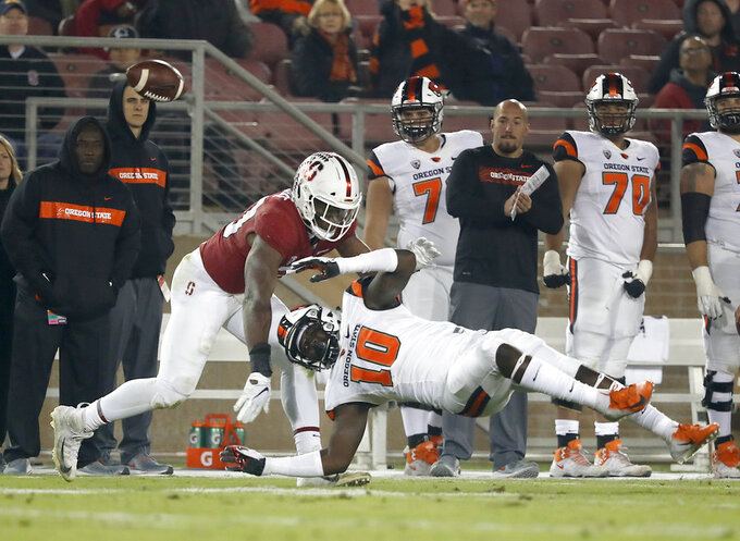 Stanford linebacker Bobby Okereke (20) breaks up a pass for Oregon State tight end Isaiah Smalls (10) in the first half during an NCAA college football game on Saturday, Nov. 10, 2018, in Stanford, Calif. (AP Photo/Tony Avelar)