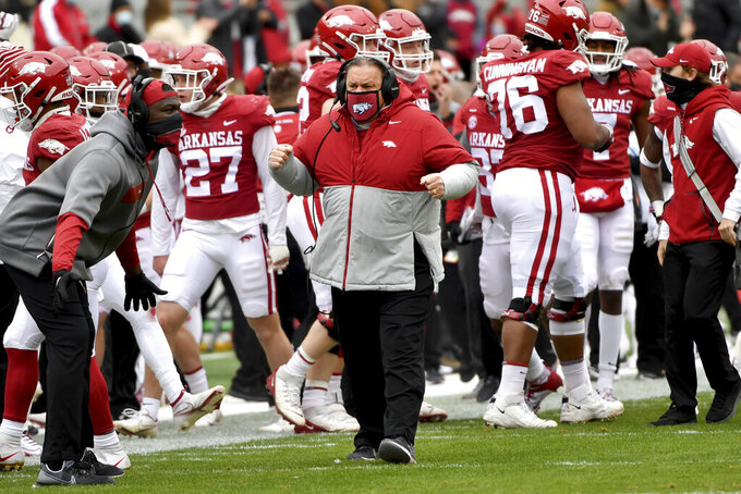 Arkansas coach Sam Pittman, center, reacts after a big play against Alabama during the first half an NCAA college football game Saturday, Dec. 12, 2020, in Fayetteville, Ark. (AP Photo/Michael Woods)