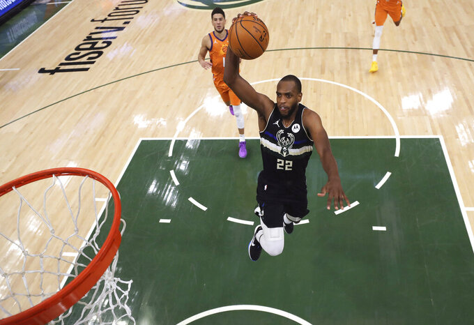 Milwaukee Bucks' Khris Middleton goes up for a dunk against the Phoenix Suns during the second half of Game 6 of basketball's NBA Finals, Tuesday, July 20, 2021, in Milwaukee. (Justin Casterline/Pool Photo via AP)