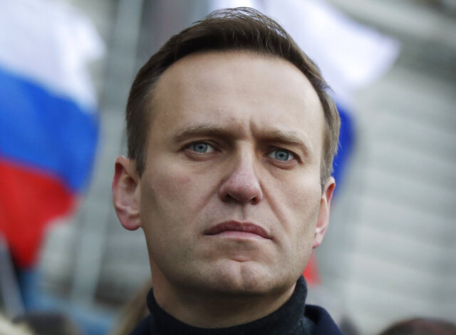 """FILE - In this file photo taken on Saturday, Feb. 29, 2020, Russian opposition activist Alexei Navalny takes part in a march in memory of opposition leader Boris Nemtsov in Moscow, Russia. The German hospital treating Russian dissident Alexei Navalny says tests indicate that he was poisoned. The Charité hospital said in a statement Monday, Aug. 24, 2020 that the team of doctors who have been examining Navalny since he was admitted Saturday have found the presence of """"cholinesterase inhibitors"""" in his system. Cholinesterase inhibitors are a broad range of substances that are found in several drugs, but also pesticides and nerve agents. (AP Photo/Pavel Golovkin, File)"""