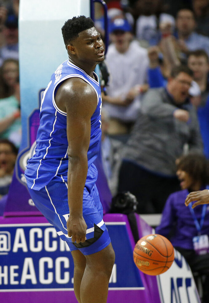 Duke's Zion Williamson (1) reacts after a dunk against North Carolina during the first half of an NCAA college basketball game in the Atlantic Coast Conference tournament in Charlotte, N.C., Friday, March 15, 2019. (AP Photo/Nell Redmond)