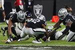 Las Vegas Raiders' Denzel Perryman (52) recovers a fumble by Baltimore Ravens quarterback Lamar Jackson (8) during the second half of an NFL football game, Monday, Sept. 13, 2021, in Las Vegas. (AP Photo/Rick Scuteri)