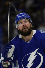 Tampa Bay Lightning right wing Nikita Kucherov (86) reacts after the team lost to the New York Islanders during Game 1 of an NHL hockey Stanley Cup semifinal playoff series Sunday, June 13, 2021, in Tampa, Fla. (AP Photo/Chris O'Meara)