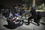 Protestors practice using a homemade slingshot at Hong Kong Polytechnic University in Hong Kong, Thursday, Nov. 14, 2019. Hong Kong police warned protesters on Thursday that they were moving
