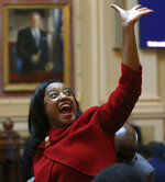 CORRECTS SPELLING TO CARROLL, NOT CAROLL - Del. Jennifer Carroll Foy, D-Prince William, waves to Equal Rights Amendment supporters in the House of Delegates gallery after the ERA resolution she sponsored passed Wednesday, Jan. 15, 2020, at the state Capitol in Richmond, Va. (Bob Brown/Richmond Times-Dispatch via AP)